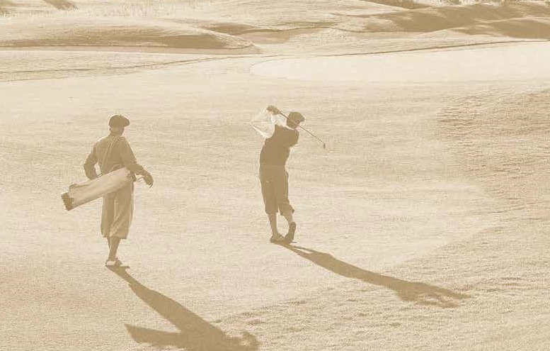 An old photograph of two men playing on the course at Somona Golf Club