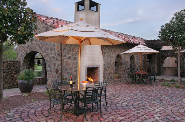 Enjoy a glass of wine outside by the fire